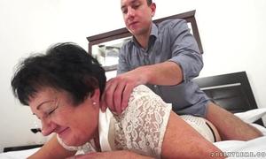 Kinky grandma screwed after massage