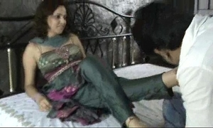 Indian wench in churidar foot worship