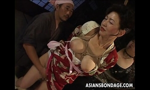Bound japanese milf moans whilst her muff is teased