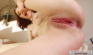 All interior redheaded receives her bawdy cleft filled by two schlongs