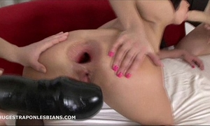 Alisya has her anal opening gaped by allies with massive dong dildos