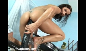 Petite european brunette hair filling her taut slit with a massive sex toy