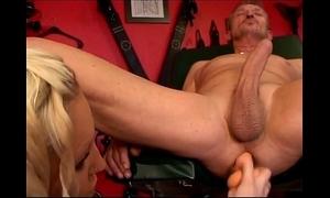 Hot blond rubbing her slave's anal opening
