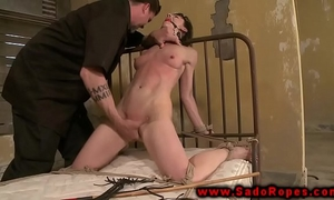 Tied up sub with gag getting whipped by her slaver