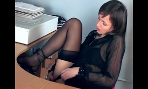 Office playgirl fingering in sheer nylons and heels